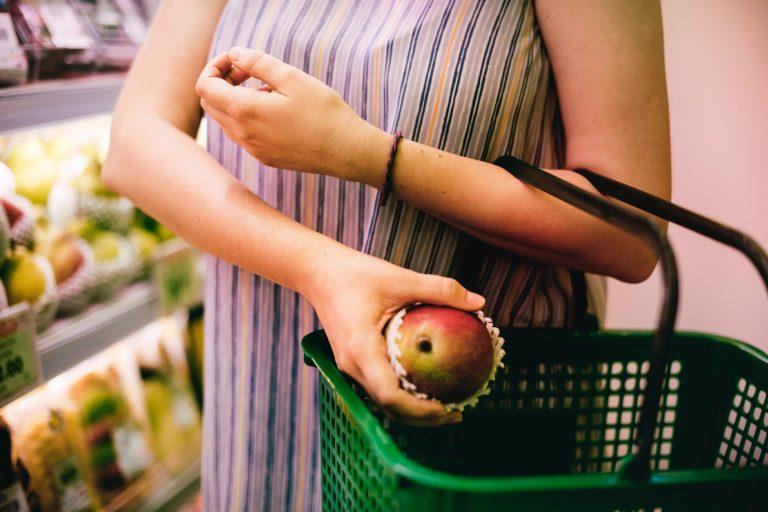 Pregnant woman choosing healthy foods
